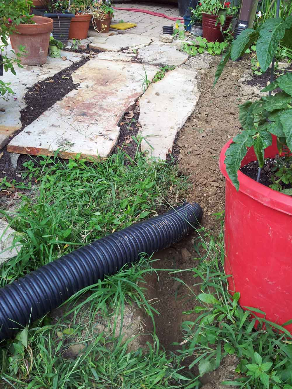 Digging-a-trench-for-downspout