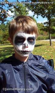 Boy with scary black and white face paint