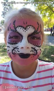 Heart face pink and purple lion face painting
