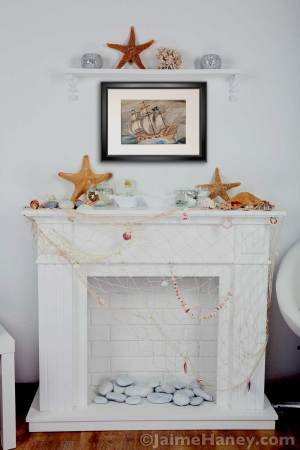 Framed and matted print of Ghost Pirate Ship shown in a living room setting