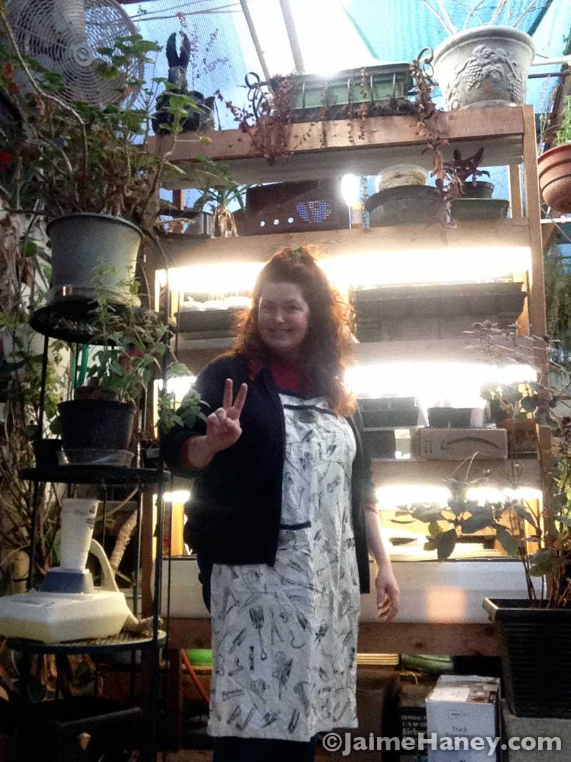 Jaime Haney, artist, in her greenhouse