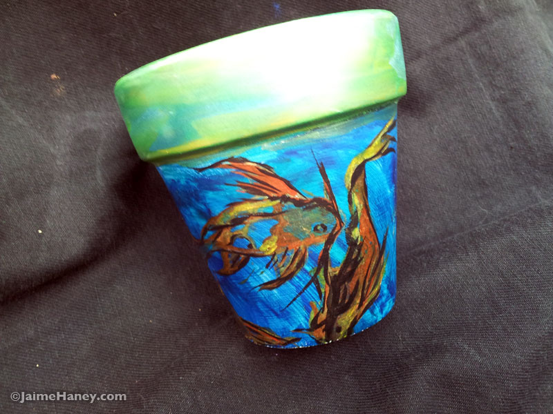 """4"""" terra cotta pot with koi fish painted on it"""