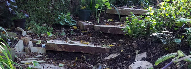 Carving rustic stone steps out of hillside with flagstone