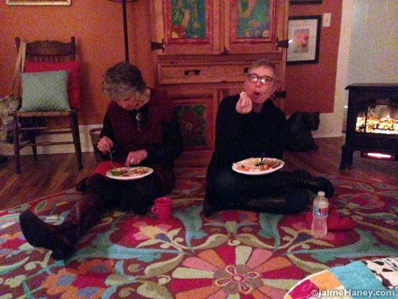 eating together on the floor for Winter Solstice Celebration
