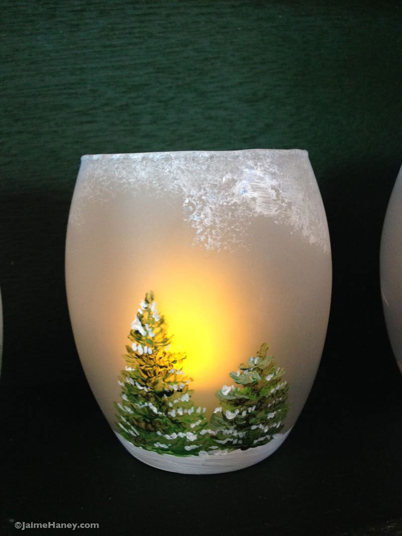 hand painted evergreen tree in the snow on a glass votive