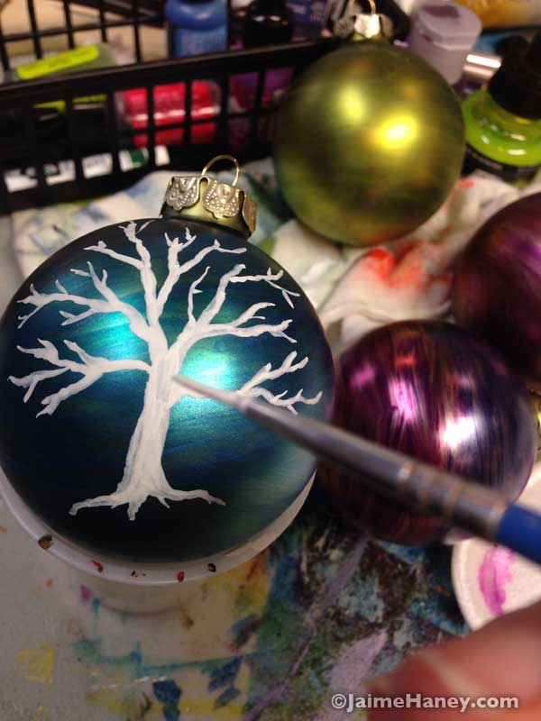 painting a winter tree on an ornament