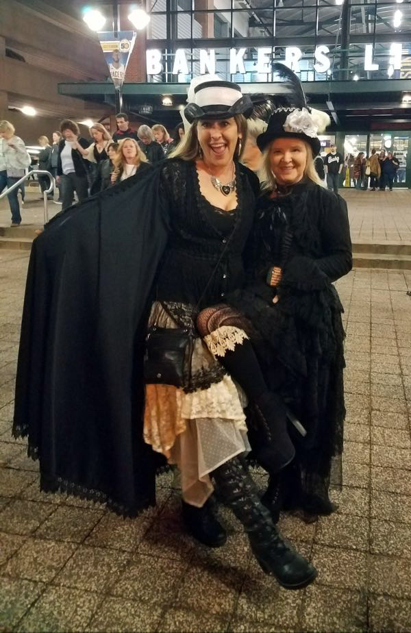 Two friends dressed up like Stevie Nicks for the 24K Gold Tour