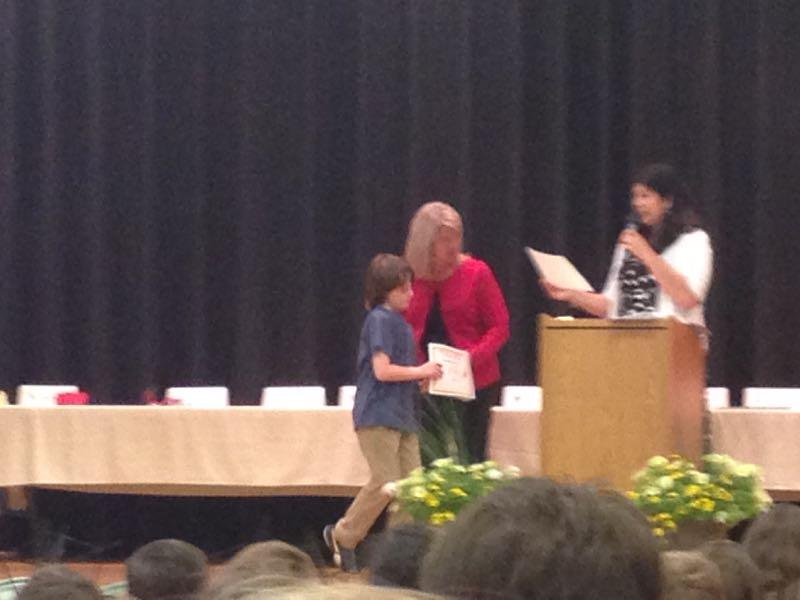 Asher getting award certificate
