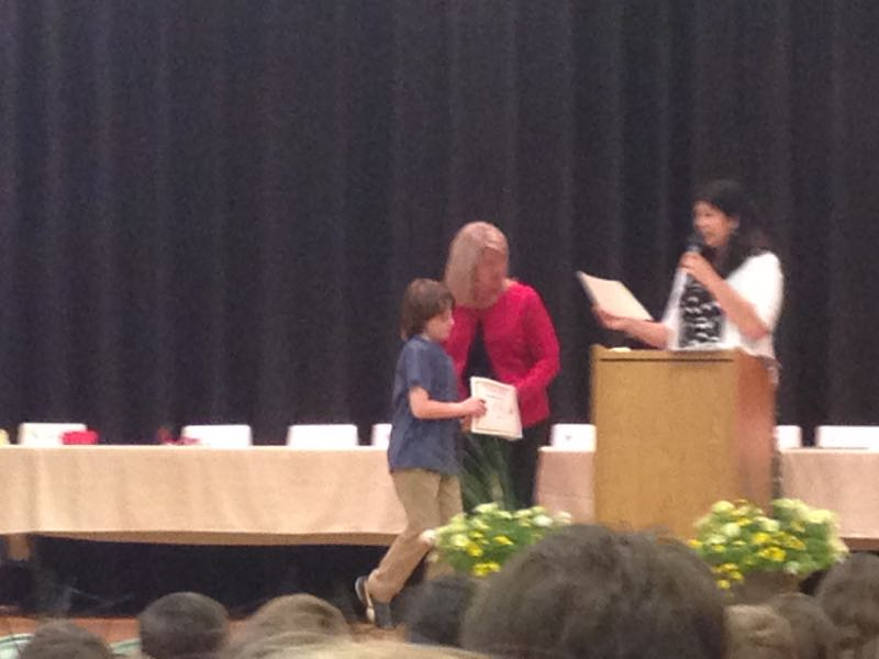 Asher getting award certificate