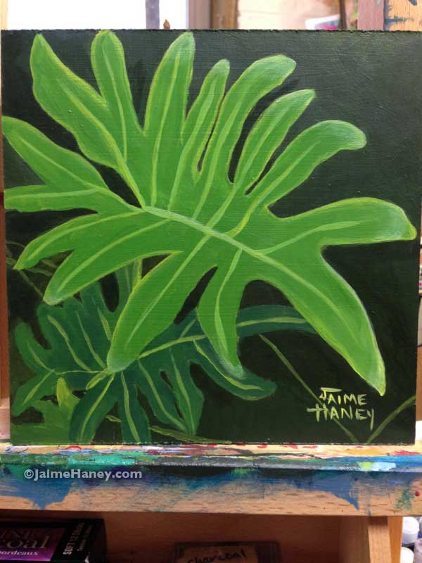 Bright green painted philodendron leaf on my easel
