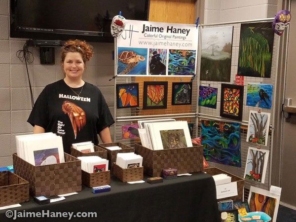 Jaime Haney at her booth at Mini Con at Alexandrian Public Library