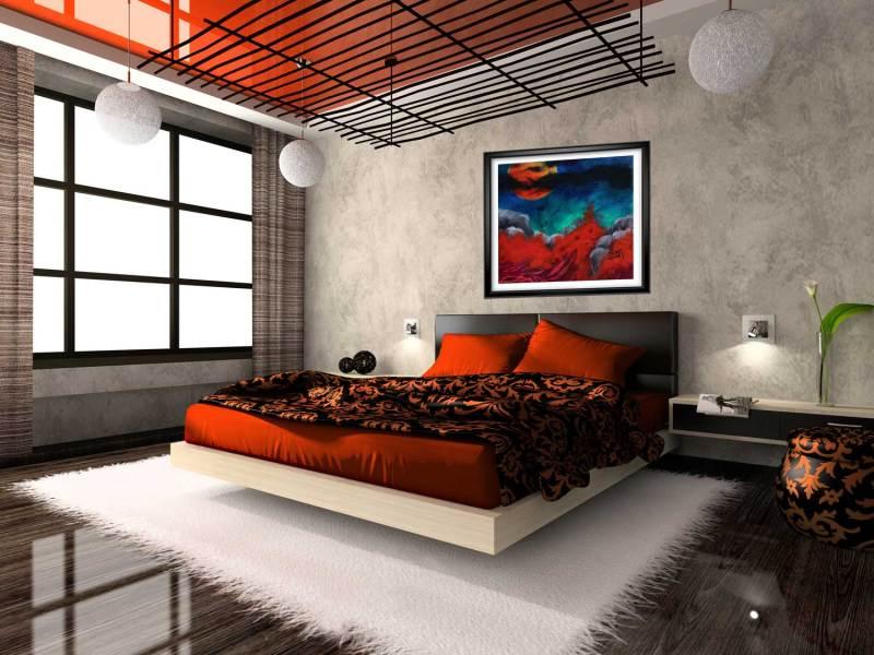 Blood moon print shown in black frame in bedroom.