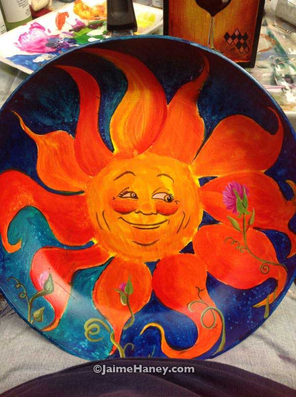 Sun Face painted on a frying pan
