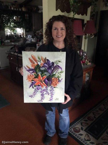Jaime Haney holding finished bridal bouquet painting