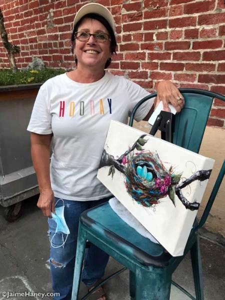 Artist with bird nest painting