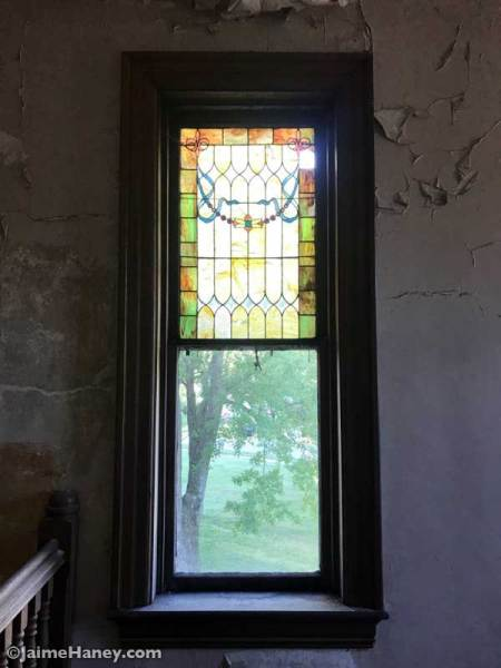 Stained glass window at the top of stairs