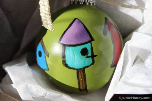 Bird houses ornament shown in gift box
