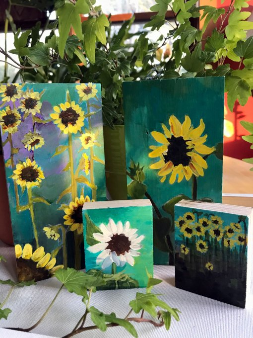 A collection of sunflower art blocks grouped together.
