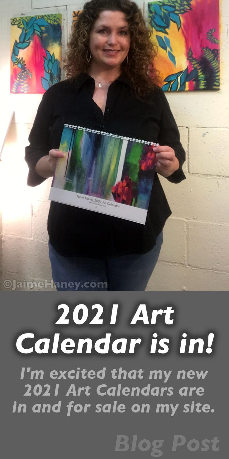 2021 art calendar held by Jaime Haney in art studio