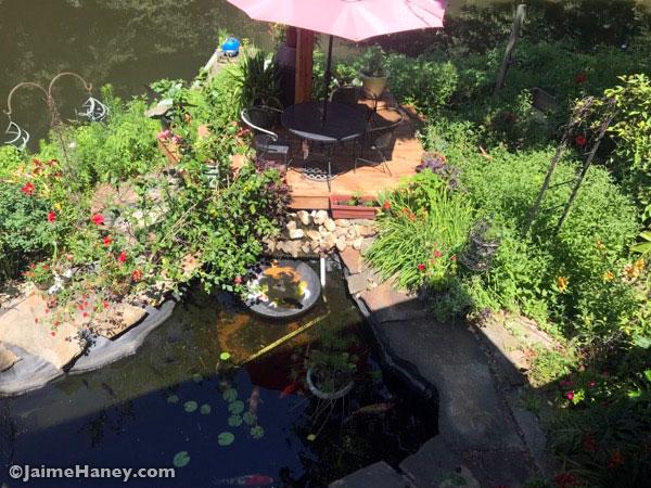 Studio Garden deck sitting area with umbrella