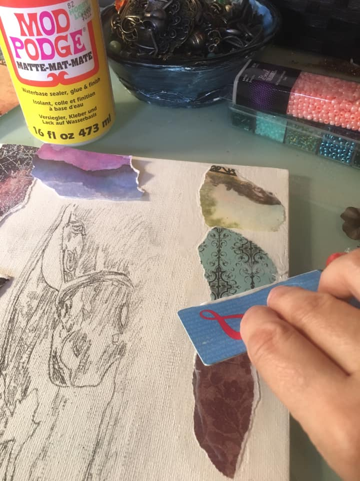 applying mod podge with plastic card