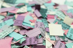 mixed media art materials pile of cut paper
