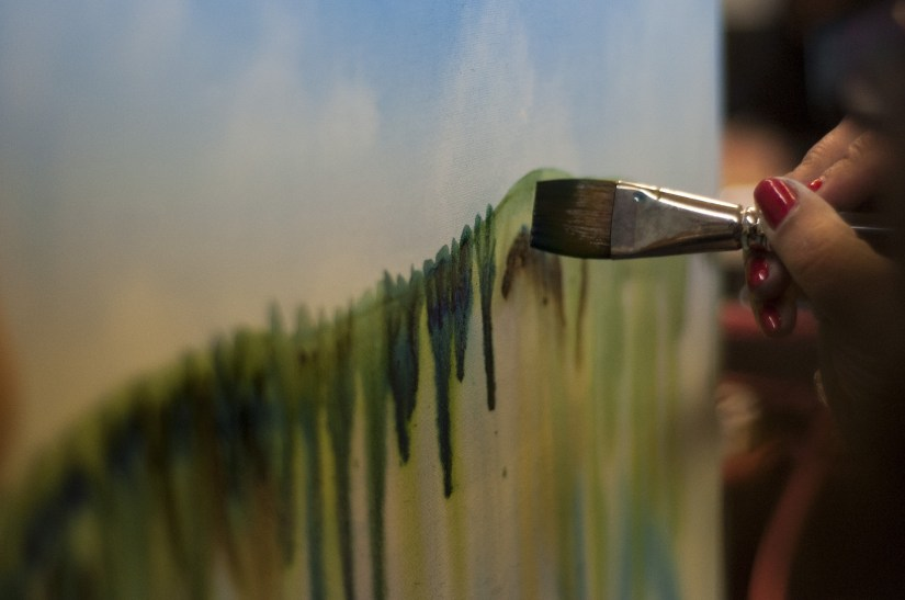 using art to cope hand with paintbrush
