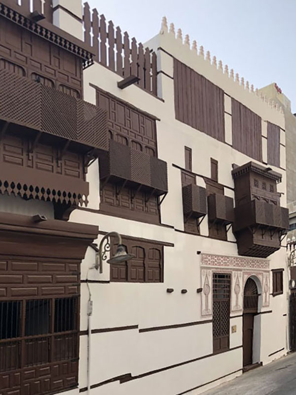 Restored coral stone facade of Jeddah AlBalad in Saudi Arabia with mashrabiyah and door decorations