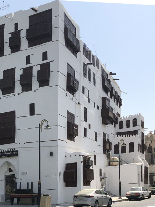 Facade of Jeddah AlBalad in Saudi Arabia white and brown with mashrabiyah roshan street scene