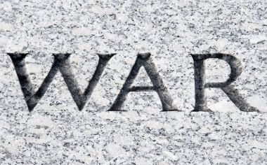 7400342-The-word-War-carved-in-stone-Stock-Photo-war-vietnam