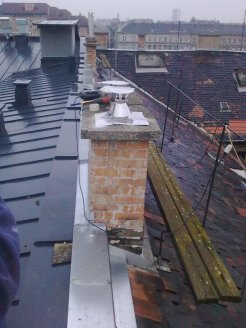 chimney outlet on the roof, with new top