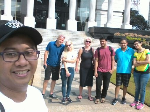 A group of Six, A Dutch family and an Indian, in front of our Court of Constitution building