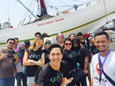 A group from Malaysian's KFIT joined our old town walking tour and amazed by how wide the traditional wooden phinisi ships are.