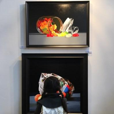 maya looking at gobstopper and gummy bear art