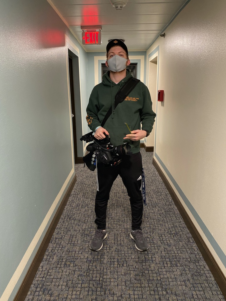 A person wearing a mask and holding a gun  Description automatically generated with medium confidence