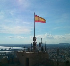 The Spanish flag dominates the horizon from up here.