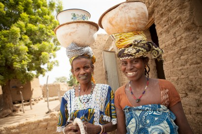 Women carry bowls on their head in Sourou Province, Burkina Faso.