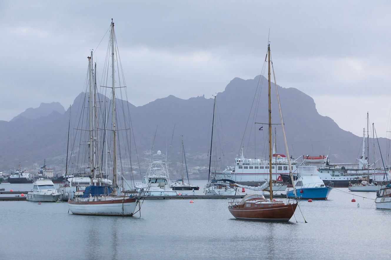 Sail boats moor in the harbor of Mindelo, Cabo Verde, the capital of the island of Sao Vicente.