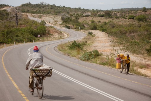 Bicycles traverse a highway outside Tanga, Tanzania.