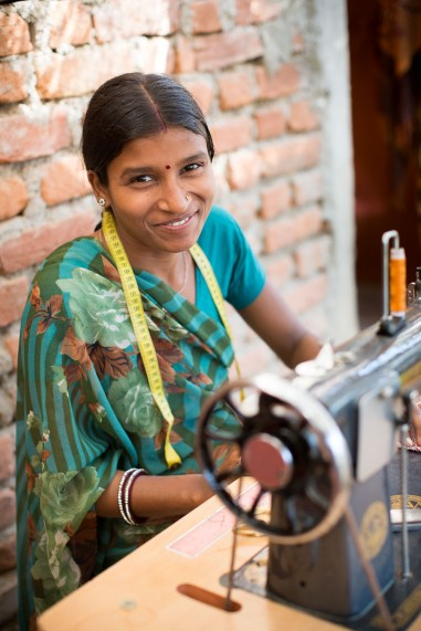 A young woman learns tailoring at a ChildFund vocational training center in Rajasthan, India.