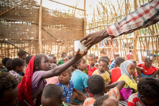 A child receives a cup of water at a drought relief center in Fentale, Ethiopia.