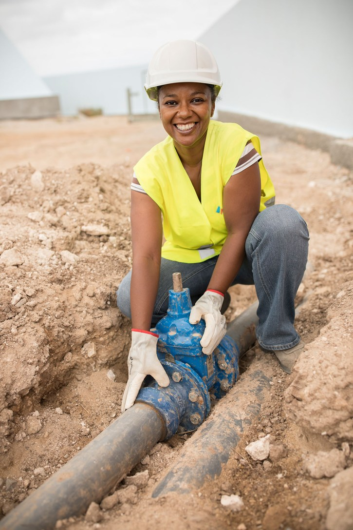 An engineer inspects a water pipe in Cape Verde.