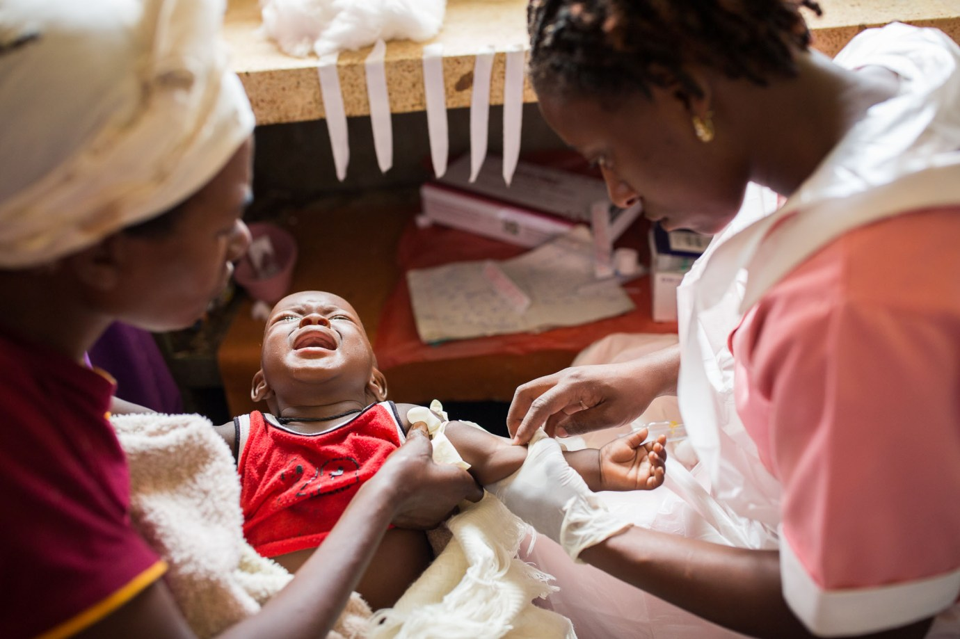 Seven-month-old Jjuma is treated for malaria at an underserved hospital in Bundibugyo, Uganda.