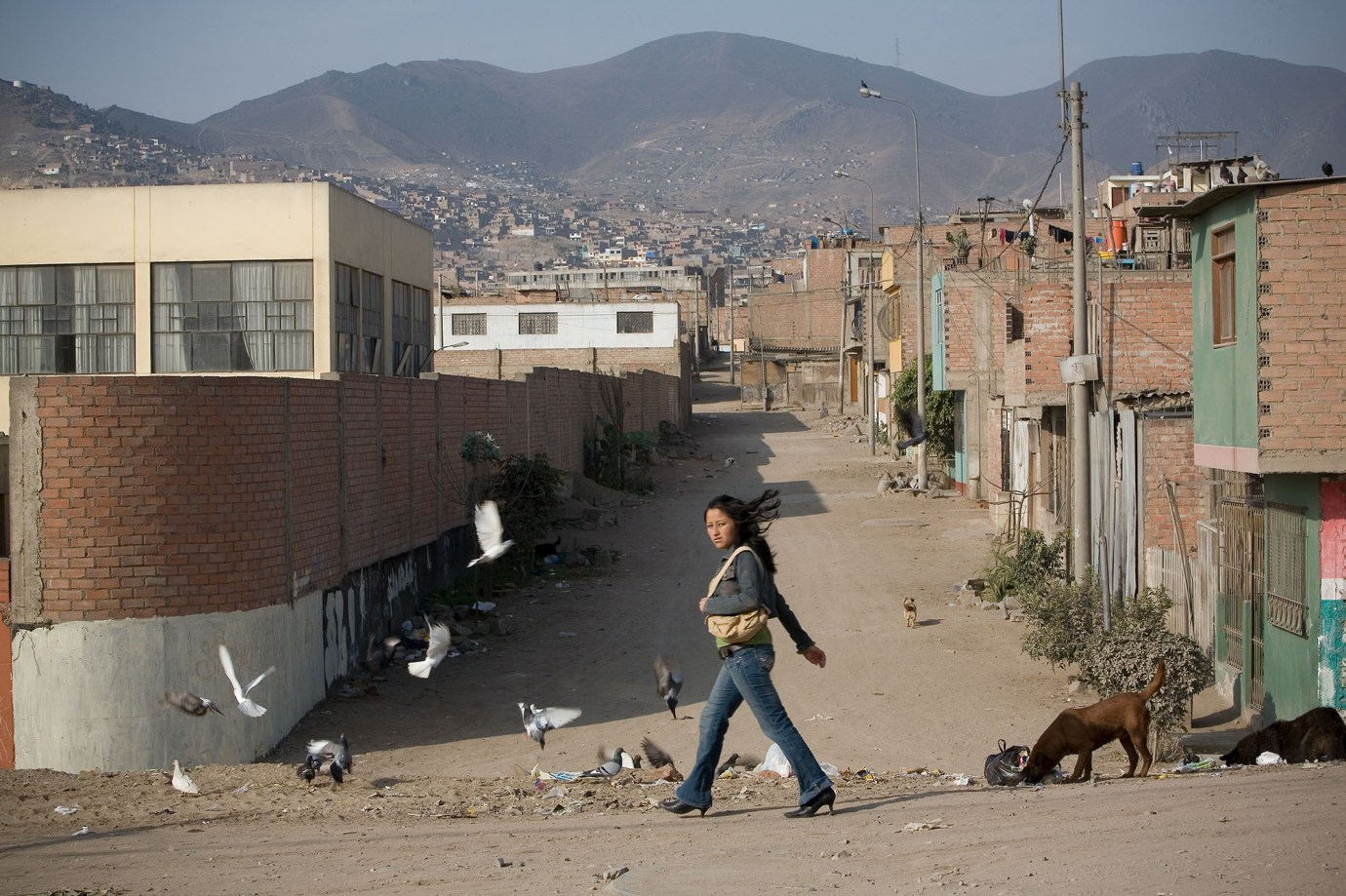 A young woman struts through San Juan de Miraflores, a suburb of Lima, Peru.