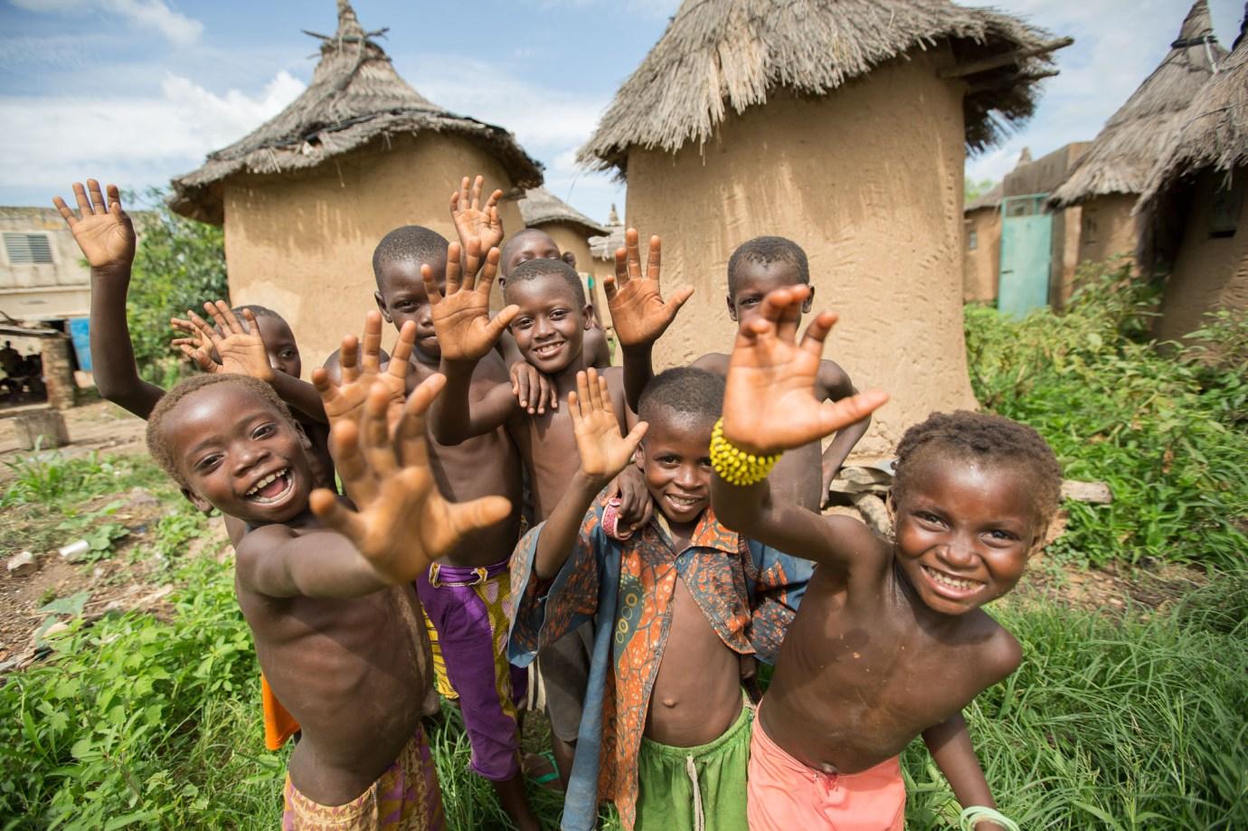 Children huddle together Burkina Faso.