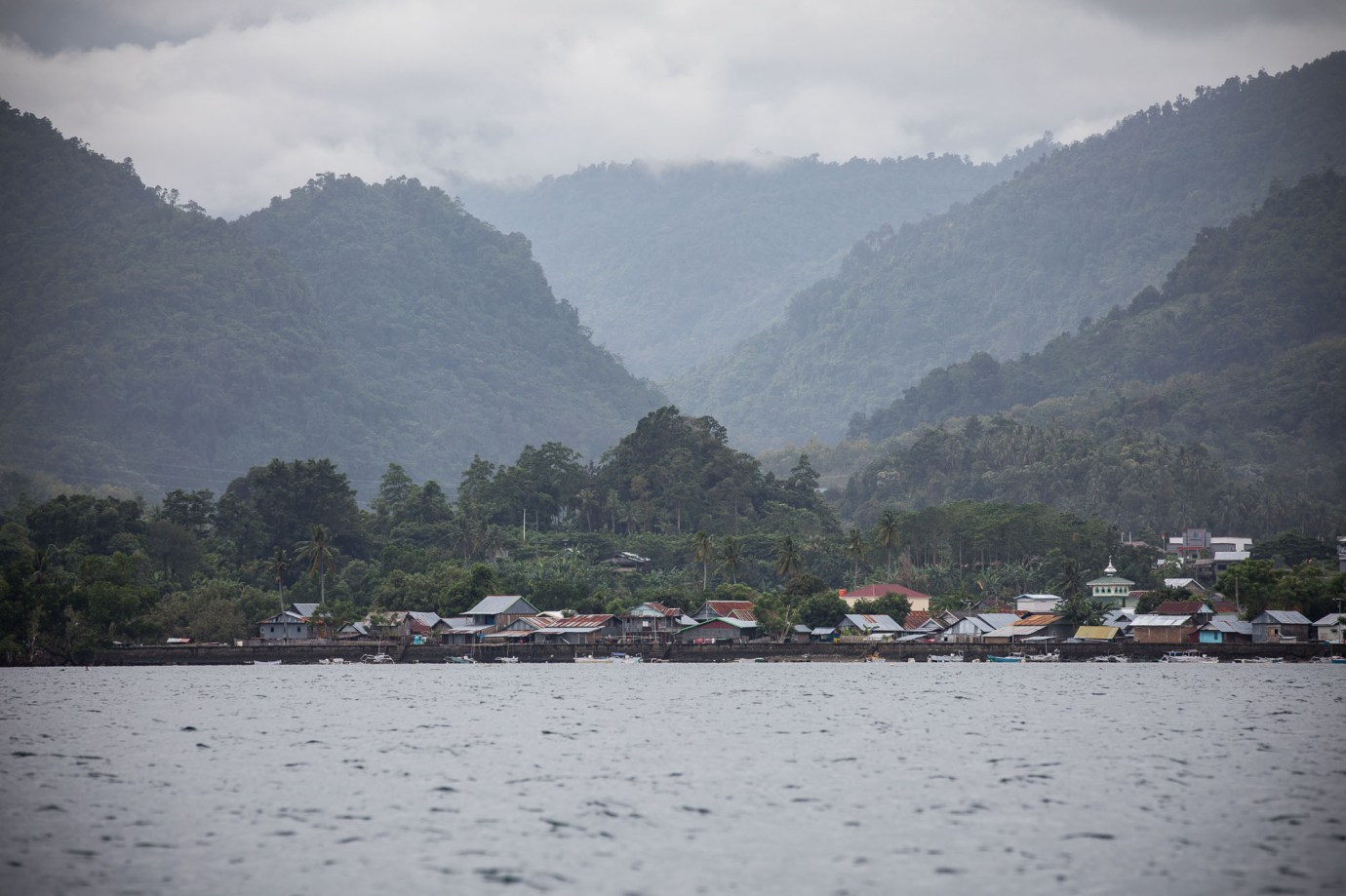 Mountains meet the shore on the Indonesian island of Sulawesi.