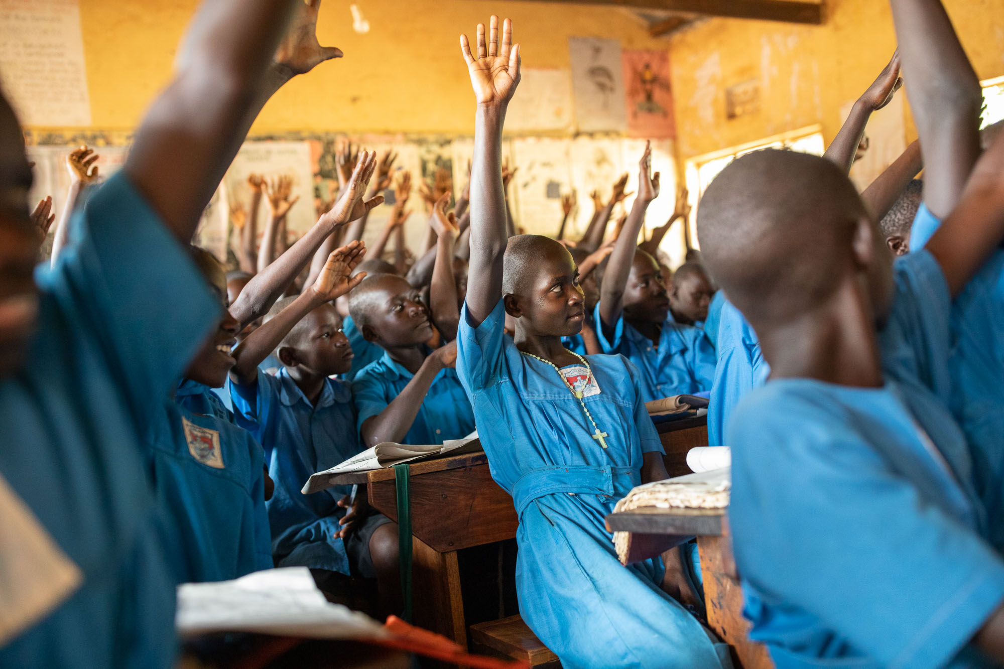 Primary school students learn in a crowded classroom in Kaberamaido District, Uganda.