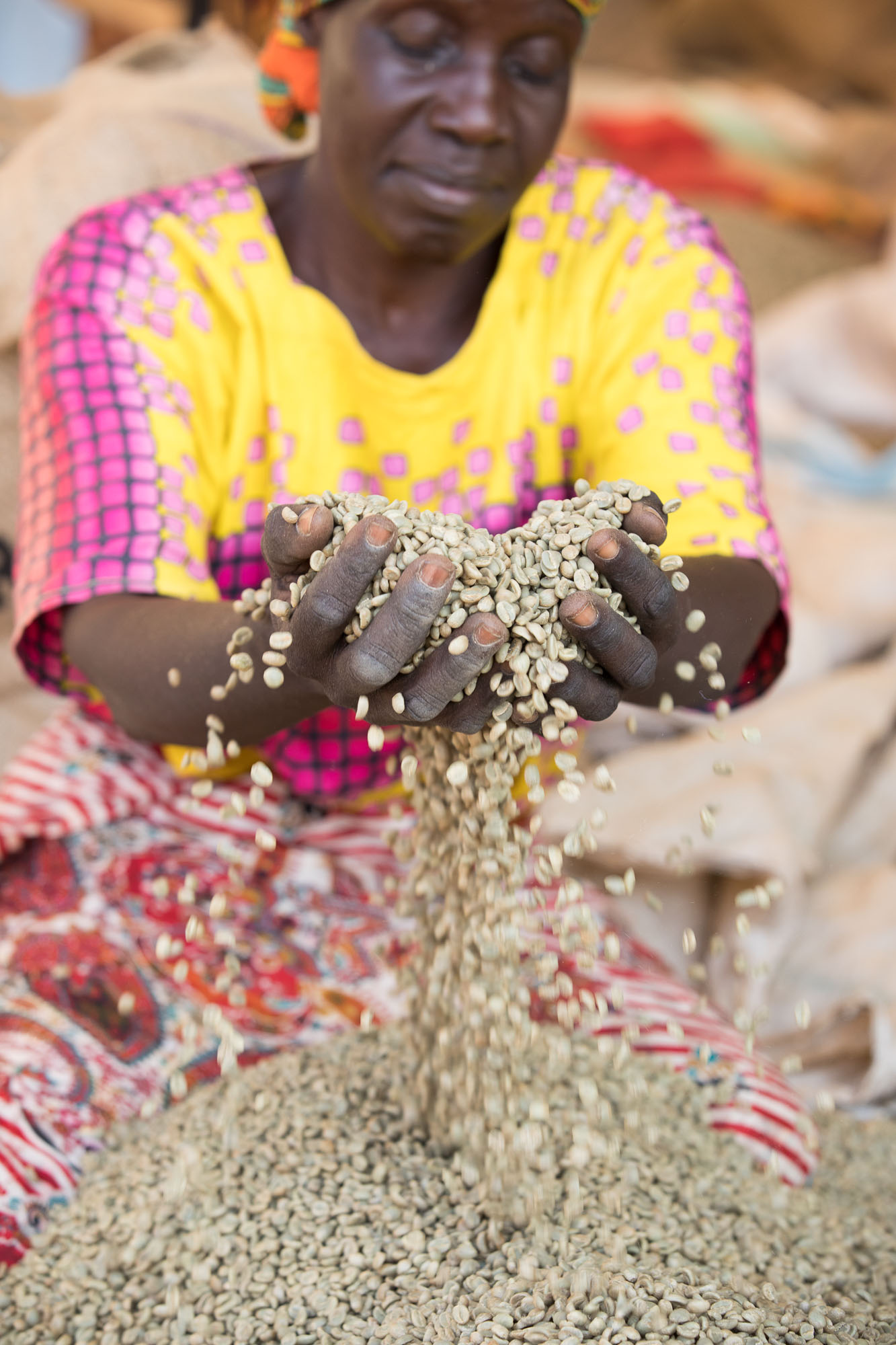 Savanna Mariam sorts coffee by hand at Mountain Harvest Coffee in Mbale, Uganda.