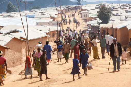 Refugees from the Democratic Republic of Congo wander the streets of newly built camp in Rwanda.