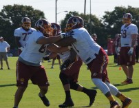 Offensive linemen Trent Williams and Tevita Stevens work on drills. Photo by Terri Russell.
